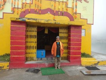 The Priest outside Lakshman Temple