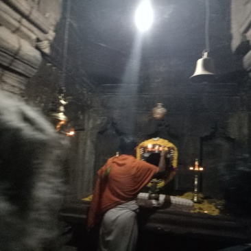 A priest performing Puja inside the temple